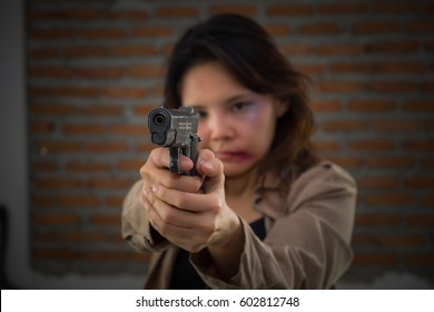 Women physically abused Hold a gun to protect yourself.