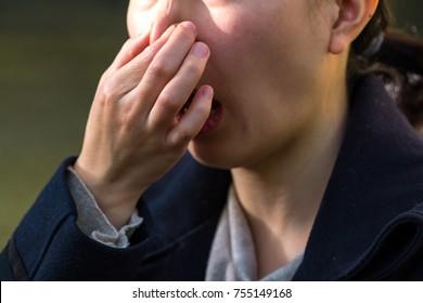Women pinch the nose