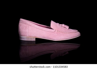 Women pink loafer shoe on black background with reflection. Fashion advertising shoes photos.