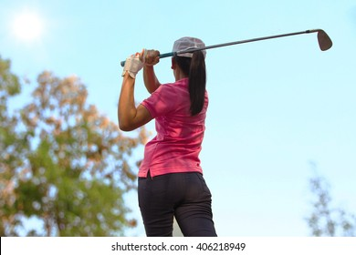 Women player golf swing shot on course in summer