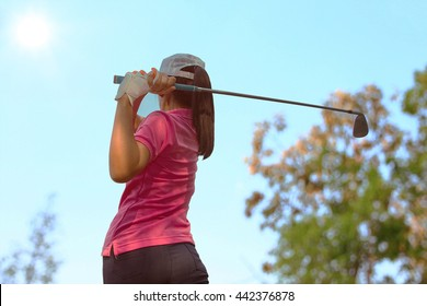 Women player golf swing shot on course in summer - Sports concept