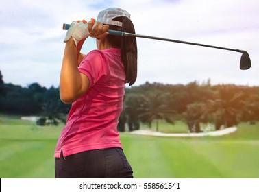 Women player golf swing shot on course