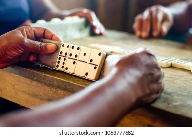 Women are playing domino which is traditional in Cuba