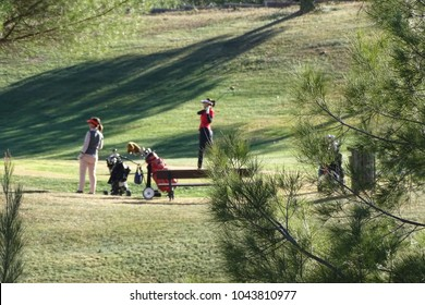 women playing golf in a green field in winter, December 16, 2017, Sant Esteve Sesrovires, Catalonia, Spain