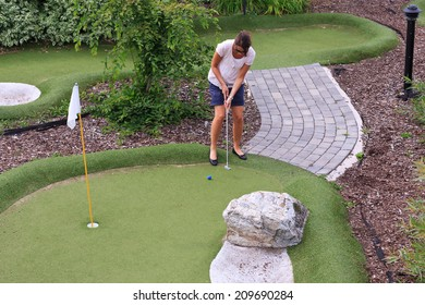 Women playing miniature golf