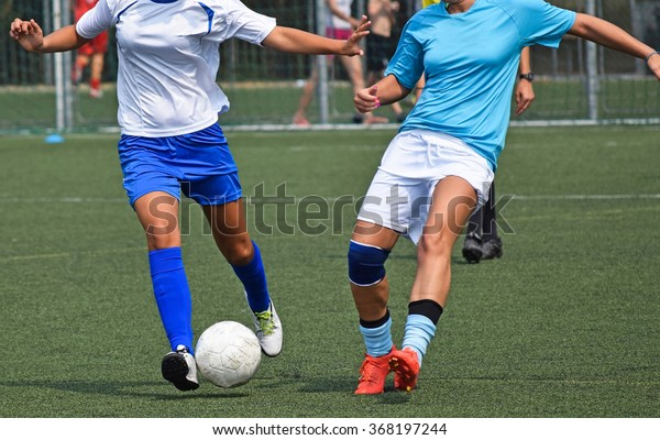 Women are playing soccer