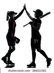 women playing softball players in silhouette isolated on white background