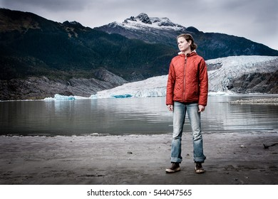 A women poses in from of the Mendenhall Glacier in Juneau, Alaska.