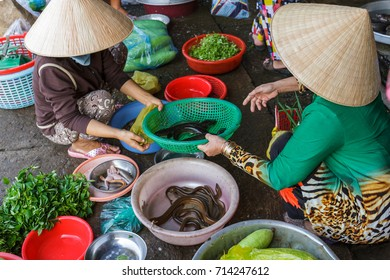 Women prepare food at a Mekong Delta market in Nga Bay, Vietnam.