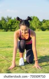 Women prepare for jogging in the park.