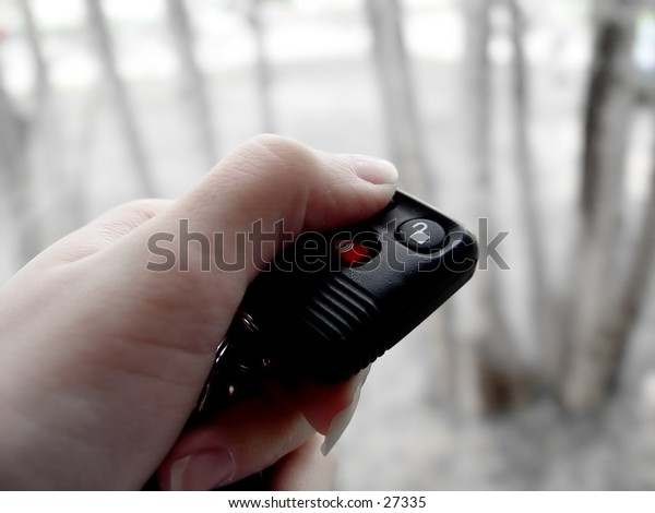 Women pressing the button on the remote start FOB, to start the car