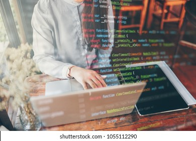 The women programmer is coding program by laptop. The foreground is a programming code. She hands typing keyboard. She creating website.