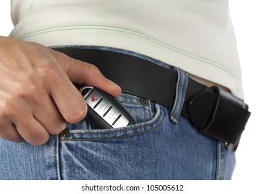 Women putting the black car key in pants jeans pocket.