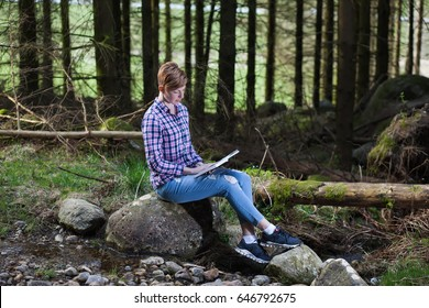 Women read a book in the forest