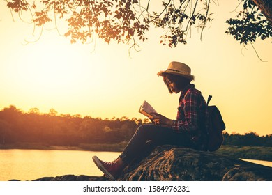 Women read book in the holiday in quiet nature, Concept reading a book.
