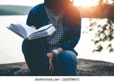 Women read books in quiet nature, concept read a books.