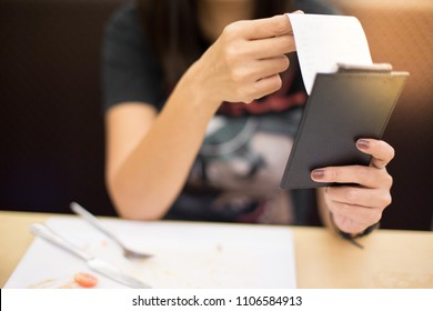 Women are reading food bill in the restaurant