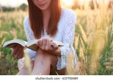 Women reading in the meadow.