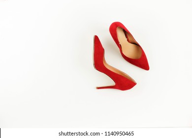 Women red high heel shoes on white background.Fashion blog look. Flat lay, top view trendy beauty female background.Copy space