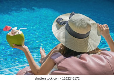 Women are relaxing at the poolside. woman relaxing in swimming pool spa. Cute girl is relaxing in the pool.Relax pool spa.Relaxing day in summer.