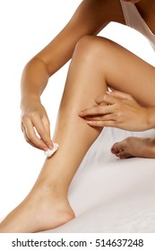 women removed the remains of wax after a legs waxing