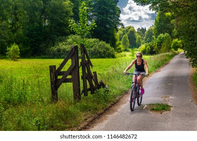 women ride on bicycles