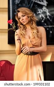 Women with roses. Beautiful woman with red roses
