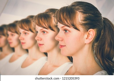 A lot of women in a row - genetic clone concept - retro style