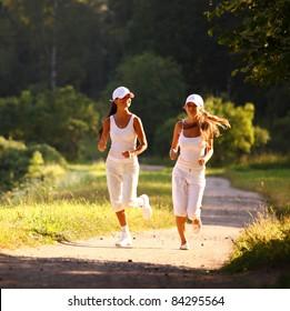 women run by sunny park alley