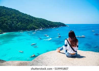 Women scenic ride Beautiful sea and blue sky at Similan island,Thailand.