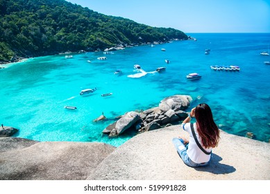 Women scenic ride Beautiful sea and blue sky at Similan island,Thailand.