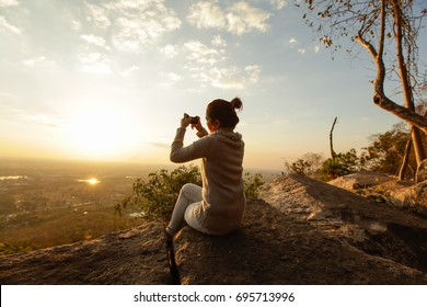 Women selfie landscape sunset.