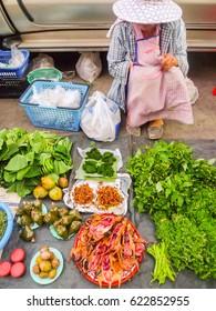 Women selling vegetables by the roadside.