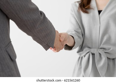Women shaking hands, contract signed, contract signed
