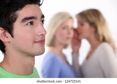 women sharing secrets about young man
