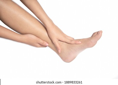 Women she is taking care of her feet. Isolated white background