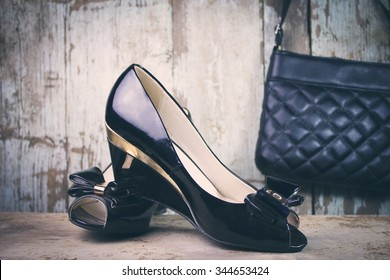 women shoes and a bag on wooden background