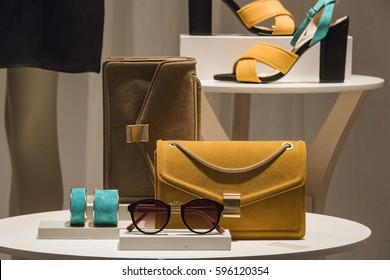 Women shoes and handbags in a fashion boutique