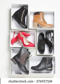 women shoes on boxes in pan