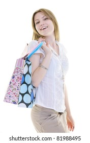 women shopping concept with young lady and colored bags  isolated over white background in studio