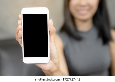 Women was show smart phones. The mobile has a black space for your pictures and text, destination technology and people concept.
