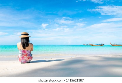 Women sitting back on the beach and sea have a holiday summer relaxing and travel bright sky koh lipe thailand
