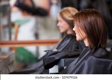 Women sitting in beauty salon.