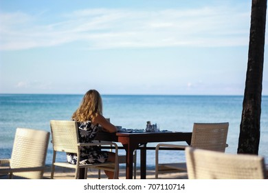 women sitting with sea view