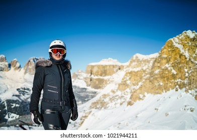 Women in Ski suit on a Slope in alps background Dolomities