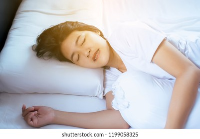 Women sleeping on the bed and grinding teeth,Female tiredness and stress