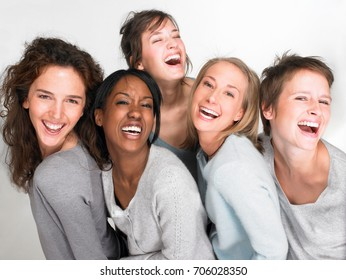 Women smiling and looking at the camera