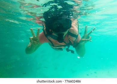 women snorkeling in the tropical sea