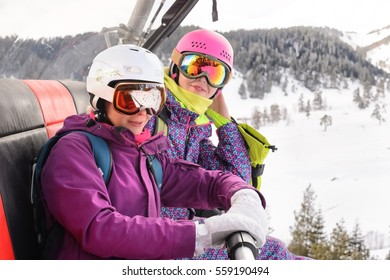 women snowboarders photographed on the phone