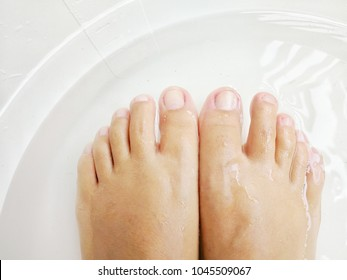 Women soak foots in the tub to relax and ready for cuting nails.